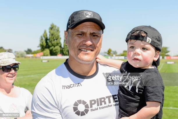 Head Coach David Kidwell of the Kiwis and his nephew Kaizell look on following a New Zealand Kiwis Rugby League World Cup training session at...