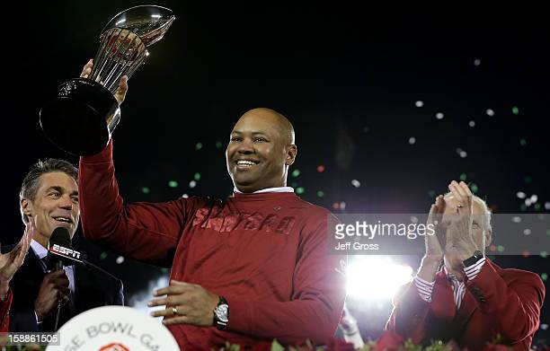 Head coach David Shaw of the Stanford Cardinal celebrates after the Cardinal defeat the Wisconsin Badgers 2014 in the 99th Rose Bowl Game Presented...