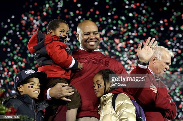 Head coach David Shaw of the Stanford Cardinal celebrates with his children Keegan Carter and Gavin after the Cardinal defeated the Wisconsin Badgers...
