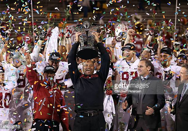 Head coach David Shaw of the Stanford Cardinal celebrates with the Pac 12 Championship trophy after defeating the Arizona State Sun Devils 3814 at...