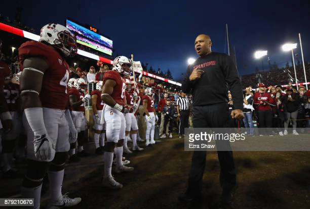 Head coach David Shaw of the Stanford Cardinal gets ready to lead his team onto the field for their game against the Notre Dame Fighting Irish at...