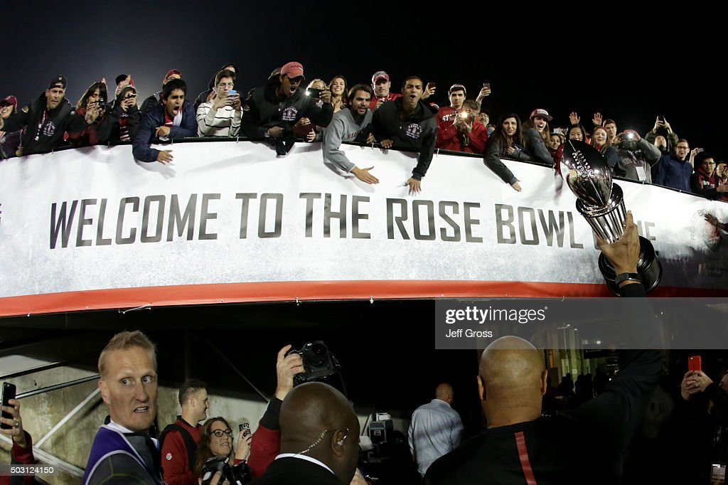 Head coach David Shaw of the Stanford Cardinal holds up the Rose Bowl trophy as he walks off the field after Stanford defeated the Iowa Hawkeyes 45-16 in the 102nd Rose Bowl Game on January 1, 2016 at the Rose Bowl in Pasadena, California.