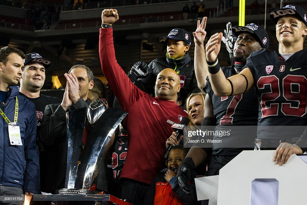 Head coach David Shaw of the Stanford Cardinal is presented with the championship trophy after the Pac-12 Championship game against the USC Trojans at Levi's Stadium on December 5, 2015 in Santa Clara, California. The Stanford Cardinal defeated the USC Trojans 41-22.