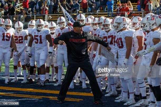 Head coach David Shaw of the Stanford Cardinal leads his team on to the field before the game against the California Golden Bears at California...