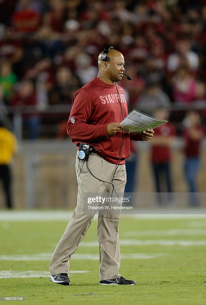 Head Coach David Shaw of the Stanford Cardinal looks over his game plan during a break in the action in the third quarter against the San Jose State Spartans at Stanford Stadium on September 7, 2013 in Palo Alto, California. The Cardinals won the game 34-13.