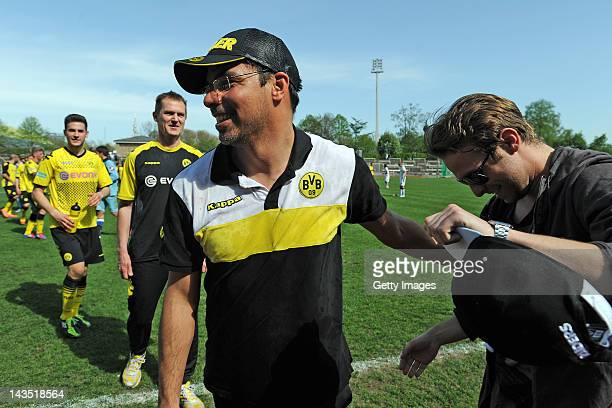 Head coach David Wagner of Dortmund and Marc Klopp of Dortmund celebrate after winning the Regionalliga West match between Borussia Dortmund II and...