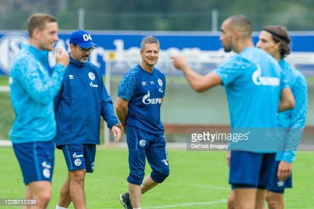 Head coach David Wagner of FC Schalke 04 and Athletic coach Werner Leuthard of FC Schalke 04 look on during the FC Schalke 04 Training Camp on August...