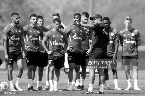 Head coach David Wagner speaks to the team during the FC Schalke 04 training session at Training Ground on July 01, 2019 in Gelsenkirchen, Germany.