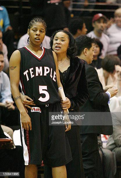 Head coach Dawn Staley cuts down the nets on her third consecutive A-10 title. The Temple Lady Owls defeated the George Washington Colonials 59 to 54...