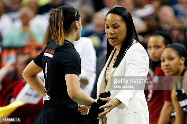 Head coach Dawn Staley talks to Bianca Cuevas of the South Carolina Gamecocks in the first half against the Notre Dame Fighting Irish during the NCAA...