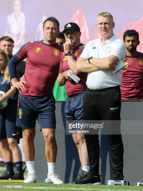 Head coach Dean Smith of Aston Villa and assistant coach John Terry look on during the pre-season friendly match between RB Leipzig and Aston Villa...