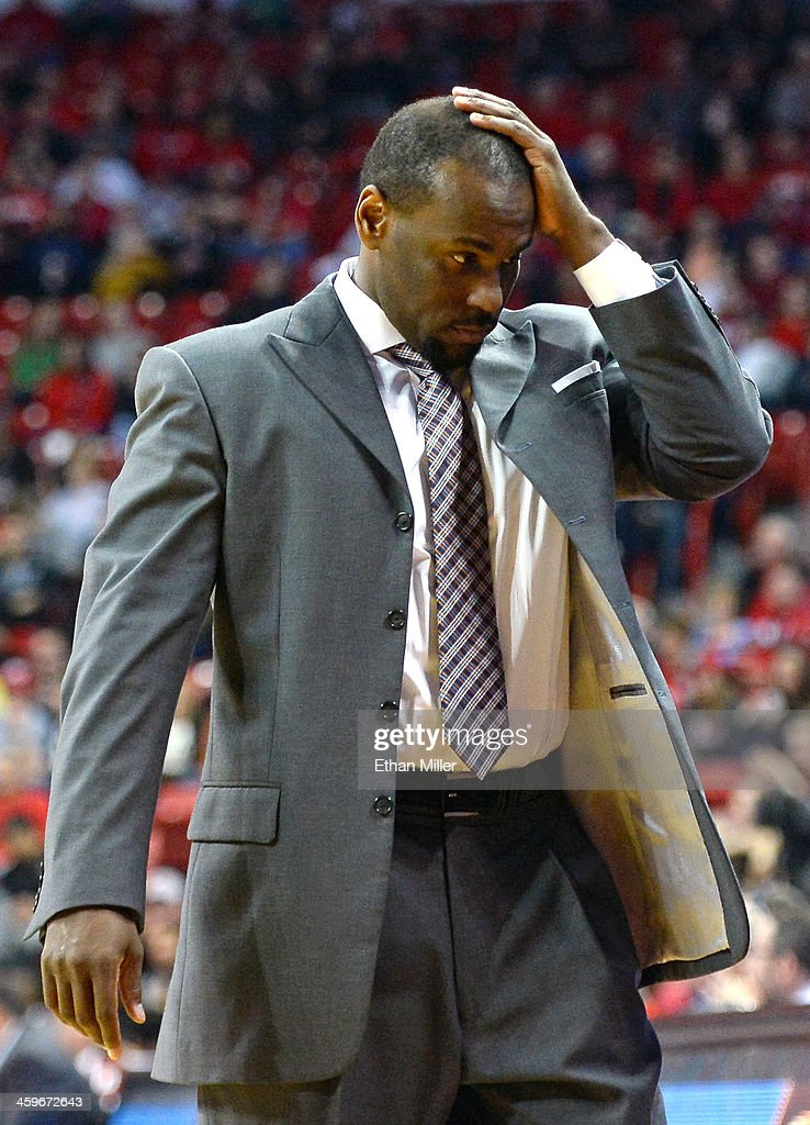 Head coach Dedrique Taylor of the California State Fullerton Titans reacts during the second half of his team's game against the UNLV Rebels at the Thomas & Mack Center on December 28, 2013 in Las Vegas, Nevada. UNLV won 83-64.