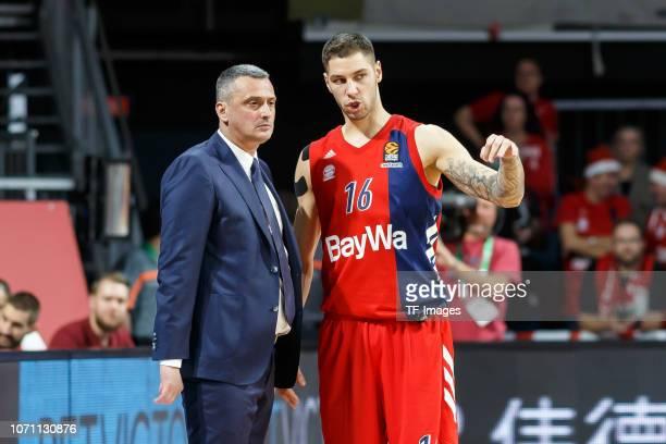 Head coach Dejan Dejan Radonjic of FC Bayern Munich speaks with Stefan Jovic of FC Bayern Munich during the Turkish Airlines EuroLeague match between...