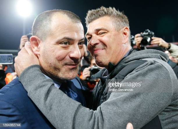 Head coach Dejan Stankovic of Crvena Zvezda greets head coach Savo Milosevic of Partizan prior to the Super Liga match between FK Crvena Zvezda and...