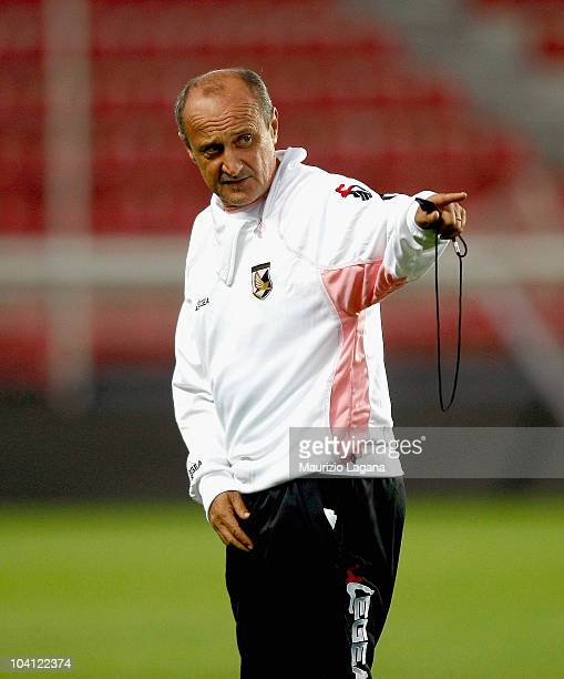 head coach Delio Rossi of US Citta di Palermo gives instructions during a training session ahead of the UEFA Europa League match against Sparta...