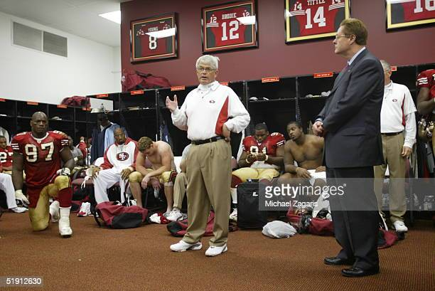 Head Coach Dennis Erickson of the San Francisco 49ers addresses the team in the locker room after the game against the Washington Redskins at Monster...