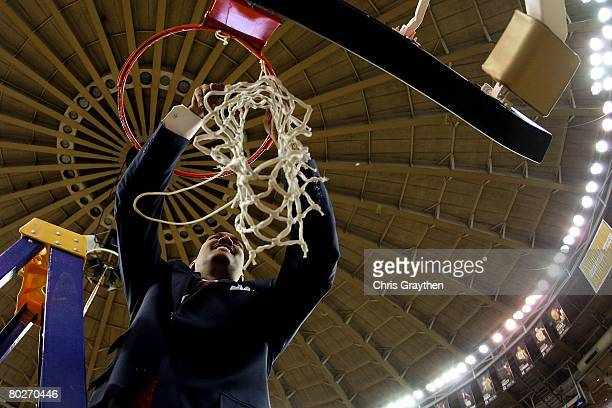 Head coach Dennis Felton of the Georgia Bulldogs celebrates by cutting down the net after defeating the Arkansas Razorbacks 66-57 during the...
