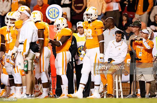 Head coach Derek Dooley of the Tennessee Volunteers sits on a stool on the sidelines during a timeout against the Alabama Crimson Tide at Neyland...
