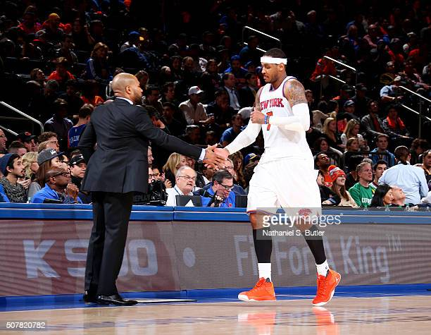 Head Coach Derek Fisher of the New York Knicks high fives Carmelo Anthony of the New York Knicks during the game against the Golden State Warriors on...