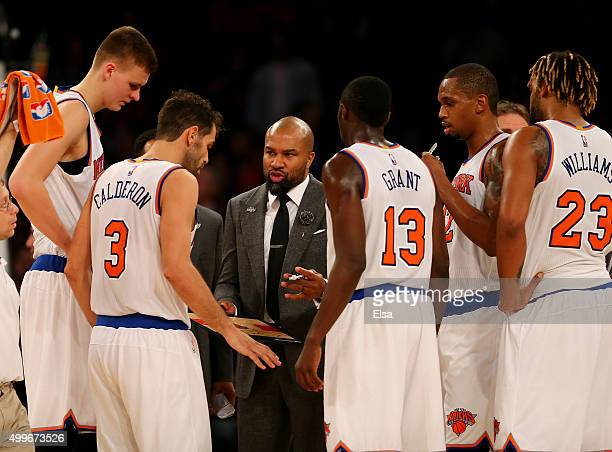 Head coach Derek Fisher of the New York Knicks talks with his team during a time out in the fourth quarter against the Philadelphia 76ers at Madison...