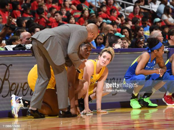 Head Coach Derek Fisher speaks with Kalani Brown and Marina Mabrey of the Los Angeles Sparks on July 18 2019 at the Staples Center in Los Angeles...