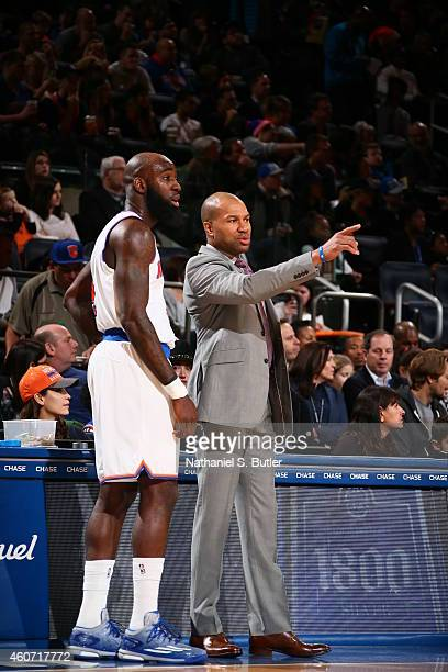 Head coach Derek Fisher talks to Quincy Acy of the New York Knicks during the game against the Phoenix Suns on December 20 2014 at Madison Square...