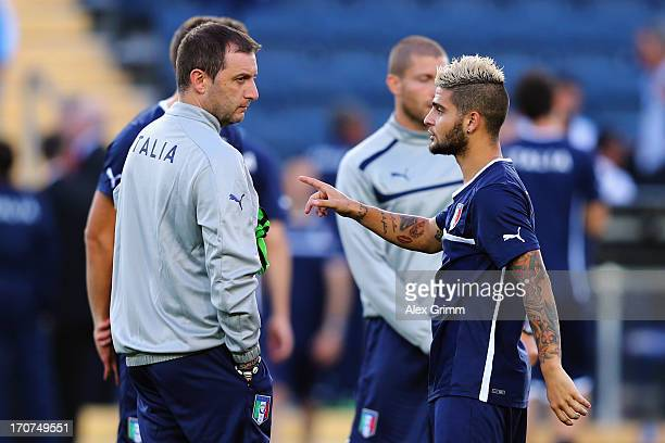 Head coach Devis Mangia and Lorenzo Insigne stand together during an Italy U21 training session at Teddy Stadium ahead of their UEFA European U21...