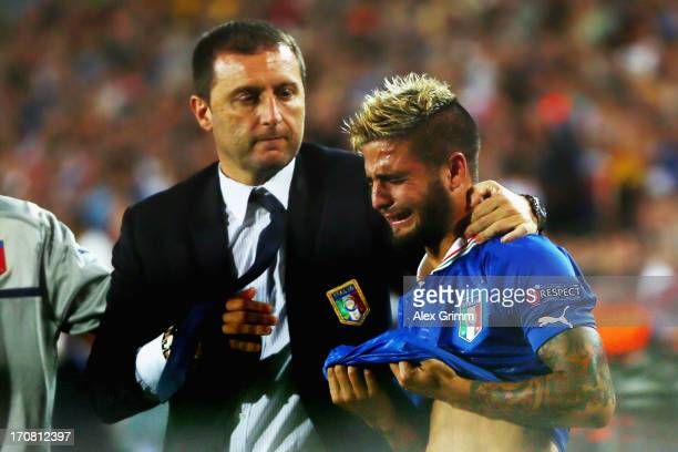 Head coach Devis Mangia of Italy comforts Lorenzo Insigne after losing their UEFA European U21 Championship final match against Spain at Teddy...