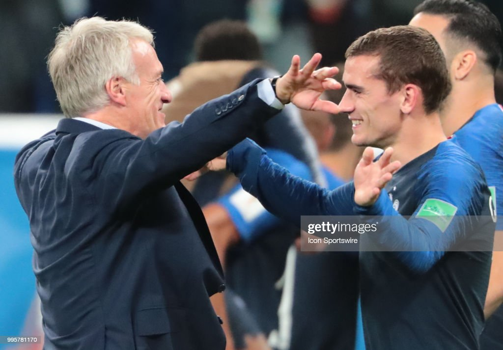 head coach Didier Deschamps of France and forward Antoine Griezmann of France celebrates winning after the 2018 FIFA World Cup Semifinal match between France and Belgium on July 10, 2018, at Saint Petersburg Stadium in Saint Petersburg, Russia.