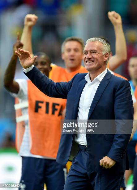 Head coach Didier Deschamps of France celebrates the first goal by Olivier Giroud during the 2014 FIFA World Cup Brazil Group E match between...