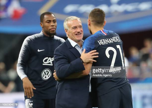 Head coach Didier Deschamps of France congratulates Lucas Hernandez after the UEFA Nations League A Group 1 match between France and Germany at Stade...