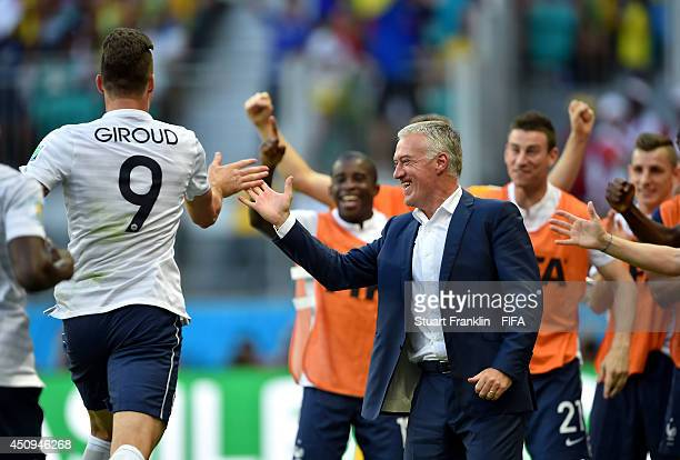 Head coach Didier Deschamps of France high fives with first goal scorer Olivier Giroud during the 2014 FIFA World Cup Brazil Group E match between...