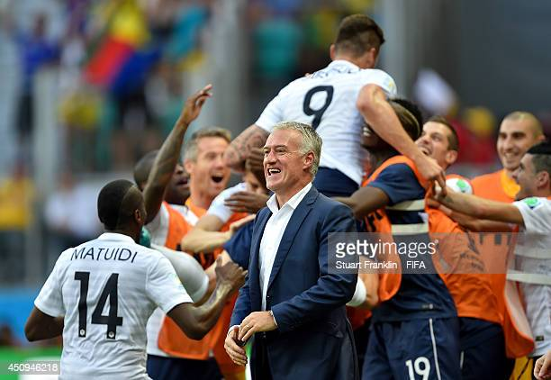Head coach Didier Deschamps of France reacts after Olivier Giroud scoring the first goal during the 2014 FIFA World Cup Brazil Group E match between...