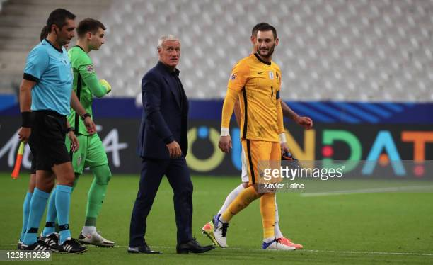 Head coach Didier Deschamps of France reacts with Hugo LLoris after the UEFA Nations League group stage match between France and Croatia at Stade de...
