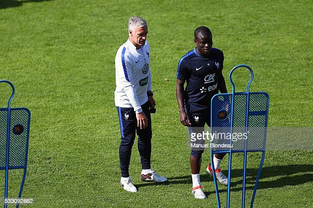 Head coach Didier Deschamps of France with Ngolo Kante during a training session during the preparation on the French football Team for Euro 2016 on...