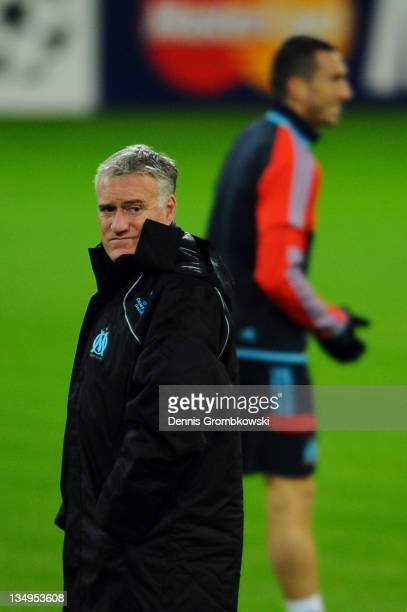 Head coach Didier Deschamps of Marseille walks on the pitch during a training session ahead of their UEFA Champions League group F match against...