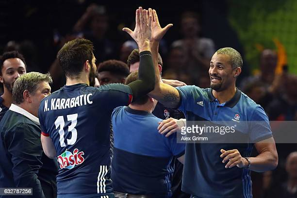 Head coach Didier Dinart of France shakes hands with Nikola Karabatic during the 25th IHF Men's World Championship 2017 Semi Final match between...