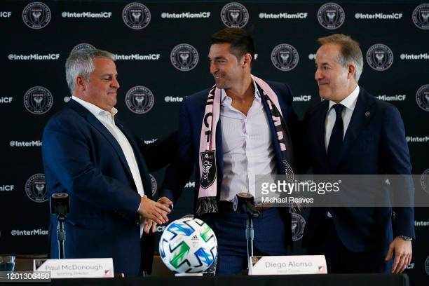 Head coach Diego Alonso of Inter Miami CF shakes hands with Sporting Director Paul McDonough and managing owner Jorge Mas at the Rusty Pelican on...