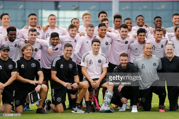 Head coach Diego Alonso owner and president of soccer operations David Beckham and owner Jorge Mas of Inter Miami CF pose for a photo with the team...