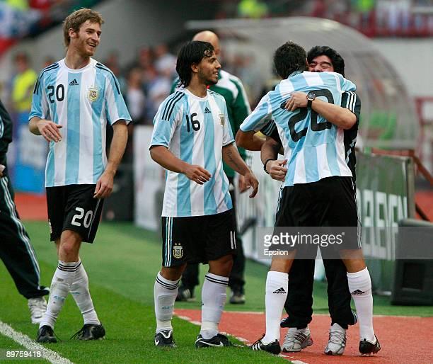 Head coach Diego Maradona Jesus Datolo Lionel Aguero and Mario Bolatti of Argentina celebrate after scoring a goal during the international friendly...