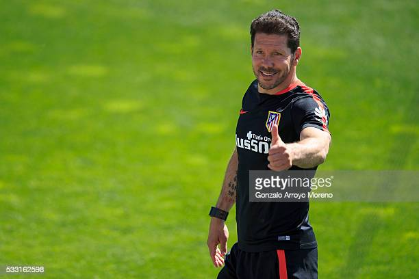 Head coach Diego Pablo Simeone gives the ok to the audience as he leaves the training session during the Club Atletico de Madrid Open Media Day ahead...