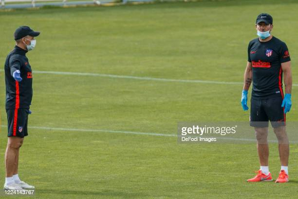 Head coach Diego Pablo Simeone of Atletico de Madrid and assistant coach Nelson Vivas of Atletico de Madrid look on during the first training session...