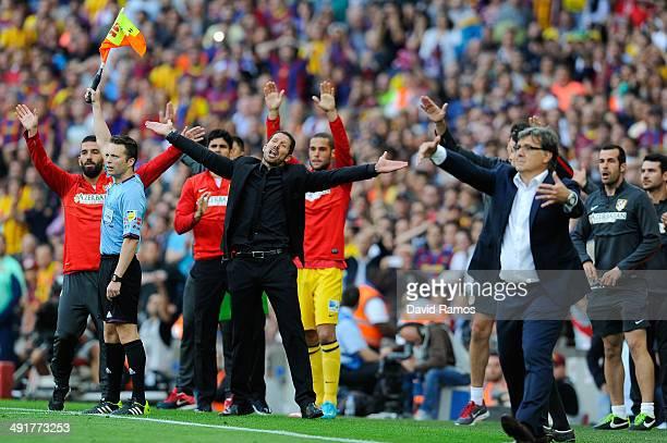 Head coach Diego Pablo Simeone of Atletico de Madrid and Head coach Gerardo 'Tata' Martino of FC Barcelona react during the La Liga match between FC...
