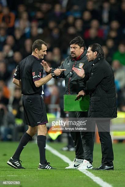 Head coach Diego Pablo Simeone of Atletico de Madrid and his assistant coach German Burgos argue with referee Clos Gomez during the Copa del Rey...