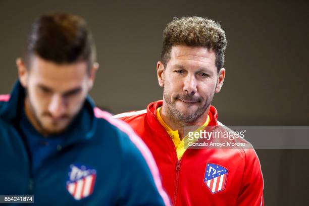Head coach Diego Pablo Simeone of Atletico de Madrid and his player Koke attend a press conference ahead of the UEFA Champions League Group C match...