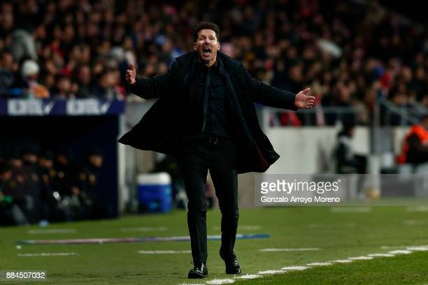 Head coach Diego Pablo Simeone of Atletico de Madrid encourages the audience during the La Liga match between Club Atletico Madrid and Real Sociedad...