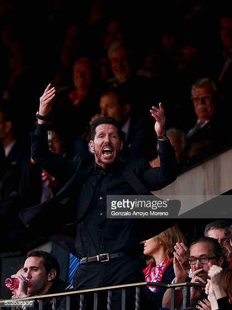 Head coach Diego Pablo Simeone of Atletico de Madrid enocourages the crowd from the grandstands expelled by refree Mateu Lahoz during the La Liga...