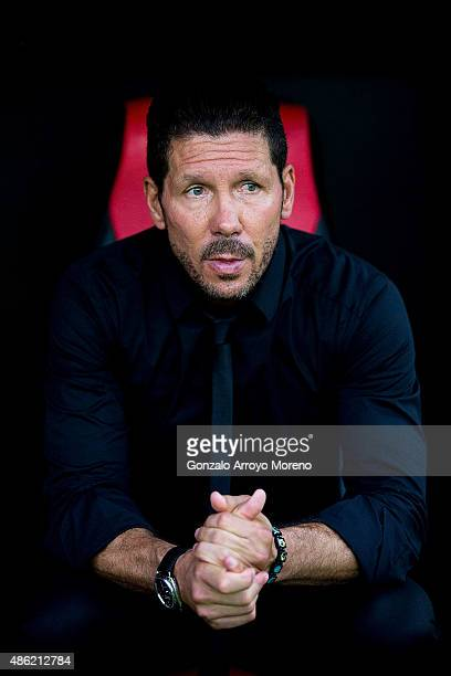 Head coach Diego Pablo Simeone of Atletico de Madrid looks on sitted on the bench prior to start the La Liga match between Sevilla FC and Club...