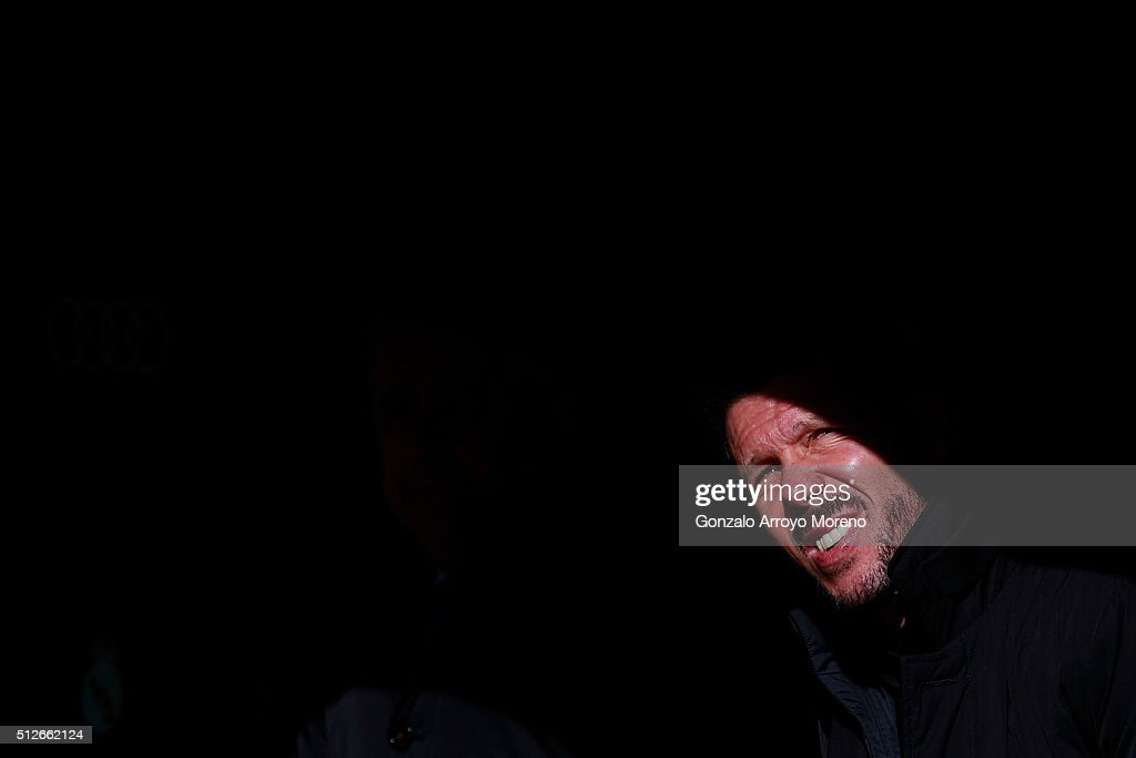 Head coach Diego Pablo Simeone of Atletico de Madrid looks up sitted on the bench prior to start the La Liga match between Real Madrid CF and Club Atletico de Madrid at Estadio Santiago Bernabeu on February 27, 2016 in Madrid, Spain.
