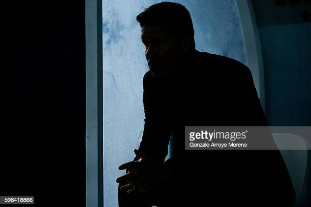 Head coach Diego Pablo Simeone of Atletico de Madrid rub his hands sitted on the bench prior to start the La Liga match between Club Deportivo...